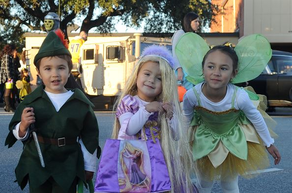 Three children dressed up for Cupertino Halloween.