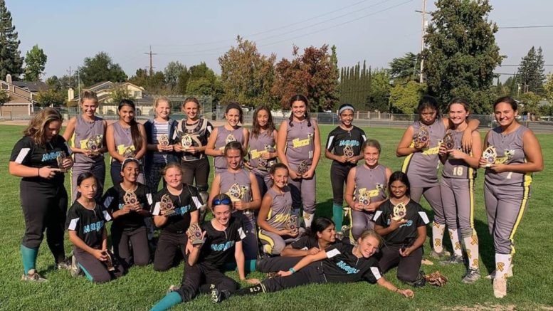 """First place Champions, """"MAGIC"""" and 2nd place finishers, """"the Buzz"""" after the 10th annual Briski Memorial Tournament on Oct. 6 and 7."""
